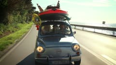 Small car filled with children toys,  road toward beach Stock Footage