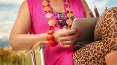 Woman tapping on a tablet PC Stock Footage