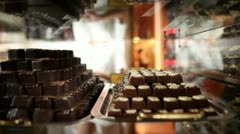 Shot of a women looking at chocolate pralines in shot with reflection on Stock Footage
