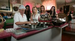 Five women making and preparing chocolate pralines Stock Footage