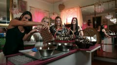 Sexy young women making chocolate pralines Stock Footage