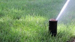 Stock Video Footage of Garden Irrigation Sprinkler watering lawn