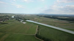 River-bed passes green valley  aerial shot Stock Footage