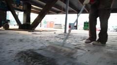 Construction site scrape cement glidecam Stock Footage