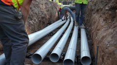 Laying pipe - stock footage