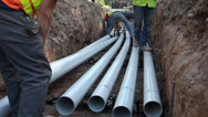 Stock Video Footage of Laying pipe