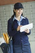 Portrait of female postal worker Stock Photos