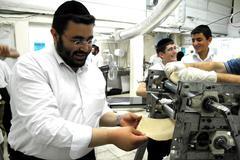 glat kosher matzah factory for jewish holiday passover - stock photo