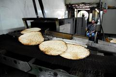 Glat kosher matzah factory for jewish holiday passover Stock Photos