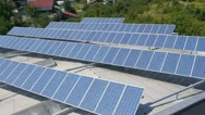 Stock Video Footage of Solar panels on factory building aerial shot