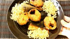rice and fish served - stock footage