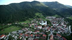 Small village near forest with big churc aerial shot Stock Footage
