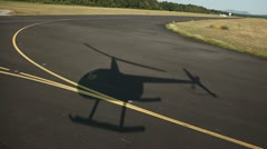 Helicopter shadow on road aerial shot - stock footage