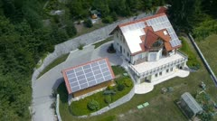 a solar panled on the roof made from sky aerial shot - stock footage