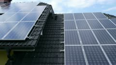 Shot from the sky of solar panels on the roof aerial shot Stock Footage