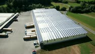 Stock Video Footage of solar power station on roof of a business building aerial shot