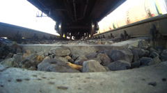 Train. The camera on the sleepers under the train - stock footage
