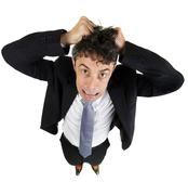 man tearing out his hair in desperation - stock photo