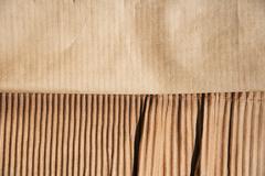 Frayed cardboard, studio shot - stock photo