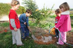 Israeli children celebrating tu bishvat jewish holiday food Stock Photos