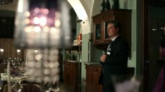 Shot of a waiter showing couple where their table is Stock Footage