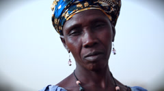 GAMBIA, 08 MARCH 2012: Afrian woman smiles into camera Stock Footage