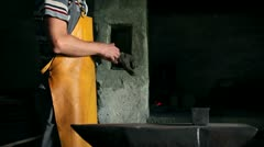 Blacksmith is putting on his glove Stock Footage
