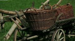 Close up shot of the old wooden cart with the big baskets on it Stock Footage