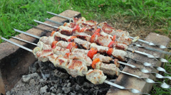 Juicy slices of meat with sauce prepare on fire Stock Footage