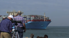 Shipspotters at quay welcoming containership on maiden voyage + zoom out Stock Footage