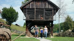 Group of people and shoot of old hayrack Stock Footage