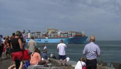 Shipspotters at quay welcoming containership on maiden voyage Stock Footage