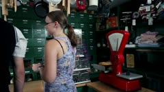 Young people buying in old retro shop Stock Footage