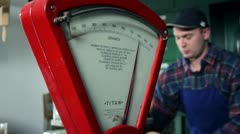 Close up shot of an old, retro, red scale and a seller in the background Stock Footage