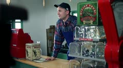 Shot of customers who are buying different things in an old, retro shop Stock Footage