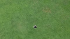 Crane shot of the hall and aproaching golf ball from above - stock footage