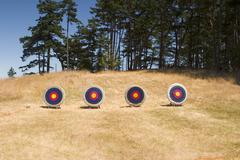 Four archery targets Stock Photos