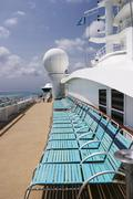 deck chairs on cruise ship - stock photo
