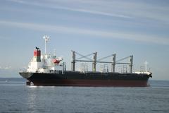 cargo freighter at anchor - stock photo
