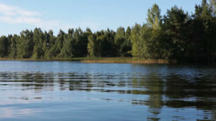 View from the motorboat at lake shore, Velye, Valday, Russia Stock Footage