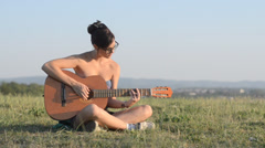 Female guitarist outdoors Stock Footage