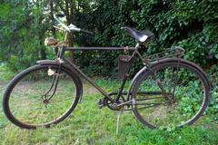 Antiquated  black bicycle - stock photo