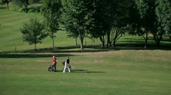 A couple on the golf course and starts preparing for playing golf Stock Footage
