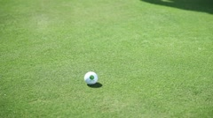 Close up shot of a golf club that hits the golf ball Stock Footage