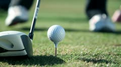 Extreme Close up shot of a golfers walk towards a point where he sticks a white Stock Footage