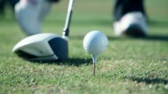 Close up shot of a golfers walk towards a point where he sticks a white golf Stock Footage