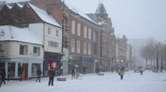 Snowing in England high street Stock Footage