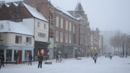 Stock Video Footage of snowing in England high street