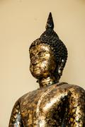 Images of Buddha cover with gold leaf - stock photo
