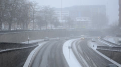 Snowing over the dual carriageway Stock Footage